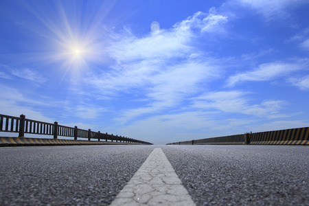 highway in steppe against a blue sky photo