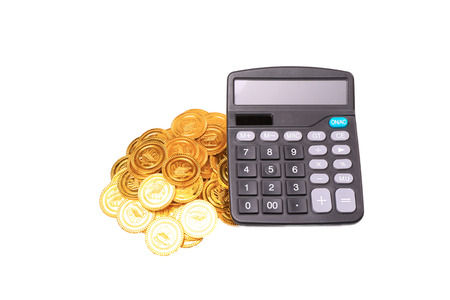 many coins and Calculator on a white background for financal contents photo