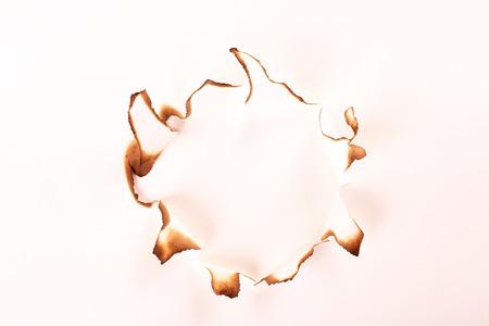 burned paper isolated on white photo