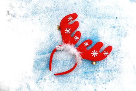 santa moose: Funny Christmas Santa reindeer headband on snow background