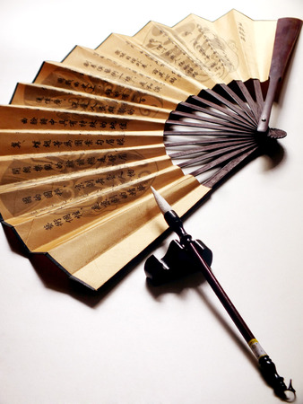 paper fan: Chinese paper fan and  brush aside Editorial
