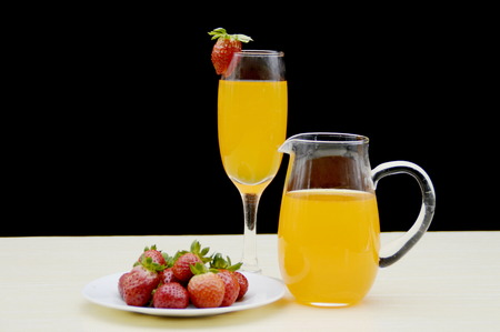 receptacle: Fruit juice and a plate of strawberries