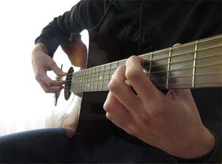 repertoire: Playing acoustic guitar with finger Stock Photo