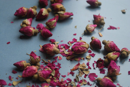 Dried purple rosebuds on a plate. Stock Photo