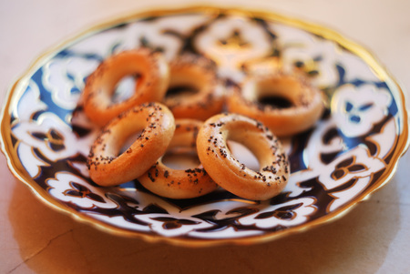 Sushki-traditional russian small bread rings with poppy seeds on top on a plate.