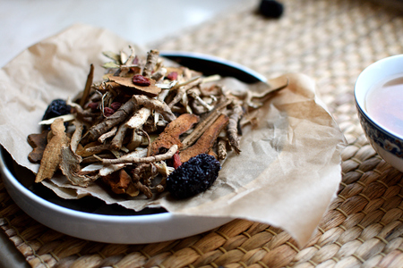Chinese traditional medicine script. Herbal tea with jujubes, goji berries, gingseng. Stock Photo