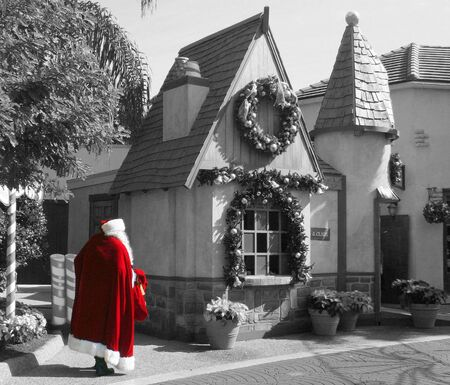Santa walking to his workshop selective color.