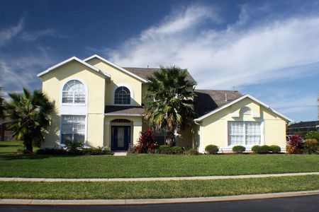 A new home in florida with blue sky.