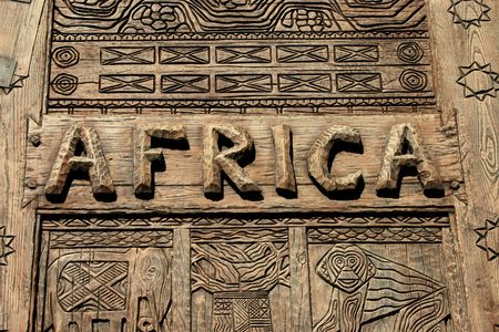 An africa sign on wood with carvings.
