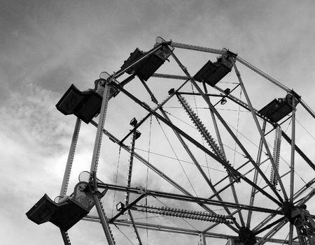 A ferris wheel in a fair ground.  Stock Photo