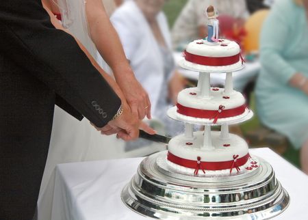 cutting: Bride and Groom cutting the Wedding Cake. Stock Photo