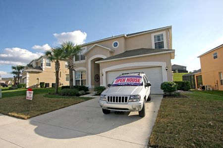 A Front Exterior of a large home, ready for an open house. Stok Fotoğraf - 4135353