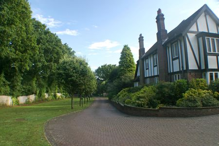 A driveway to a big tudor house in the UK. photo