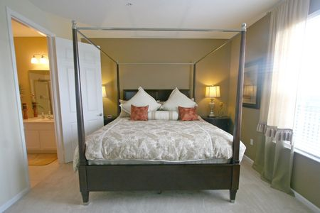 four poster bed: An Interior Home shot of a King Master Bedroom Stock Photo