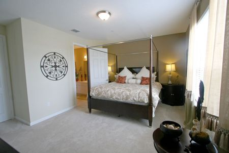 An Interior Home shot of a King Master Bedroom. photo
