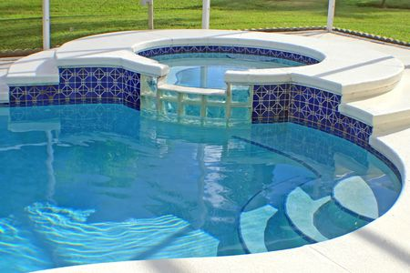 A luxurious swimming pool with a spa. Stok Fotoğraf - 5827645