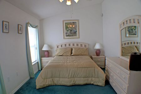 A straight on view of a master bedroom. photo
