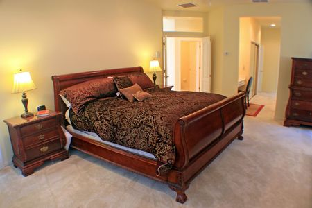 A Large Master Bedroom with sleigh bed. Stock Photo