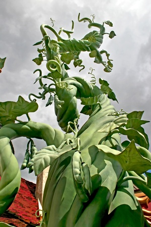 A beanstalk growing up into the sky