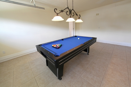 A pool table in a garage