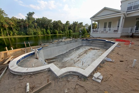 swimming pool home: A Swimming Pool under construction in Florida Stock Photo