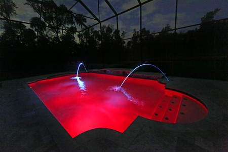 A Swimming Pool lit up at Night