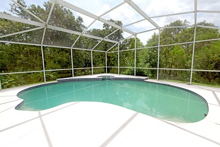 inground: A swimming pool and spa at a home in Florida
