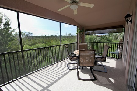 entertaining area: A balcony with a view over the trees in the conservation area
