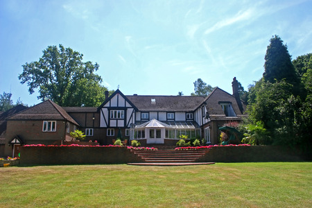 conservatory: A large estate home, tudor style, in the UK