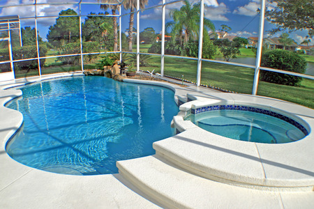 home for sale: A swimming pool and spa with a lake view.