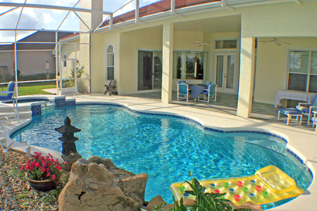 home for sale: A swimming pool, spa and lanai in Florida.