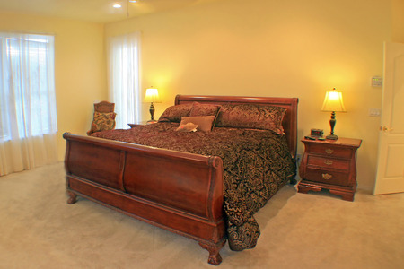 master bedroom: A Master Bedroom with a sleigh bed. Stock Photo