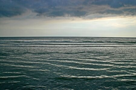 stormy waters: The ocean waters with stormy clouds above Stock Photo
