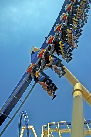 exhilerating: A Roller Coaster with Track and People in Florida.
