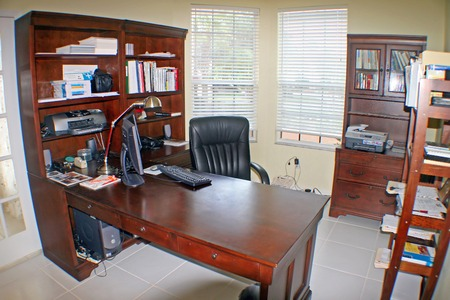 An office in a Florida Home with tile floor. photo