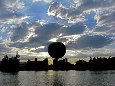 gas ball: A silhouette of a balloon and surroundings at sunset across a lake. Stock Photo