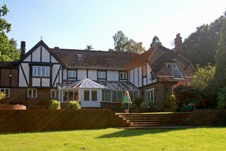 tudor: A large estate home, Tudor style, in the UK.