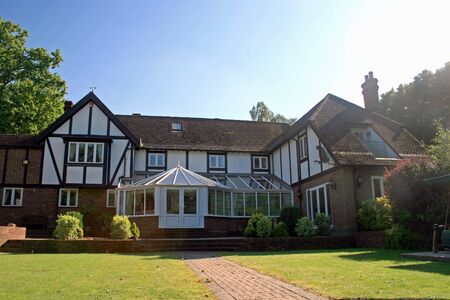 tudor: A large estate home, Tudor style, in the UK