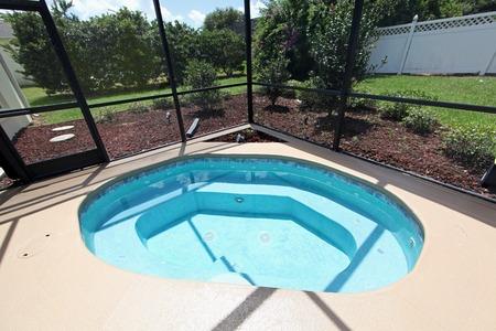 家のプールでジャグジー 写真素材