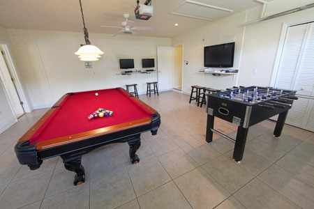 the game: A games room with pool table and foosball