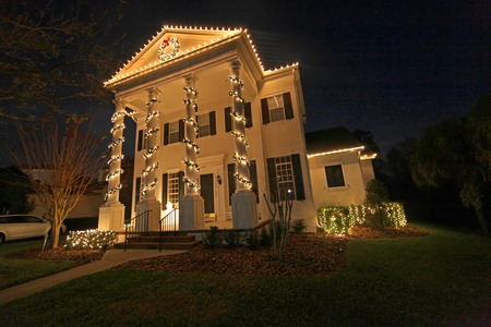 colonial house: A Colonial House with a lot of Christmas Lights