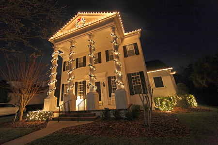christmas lights display: A Colonial House with a lot of Christmas Lights
