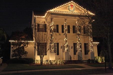 christmas light bulbs: A Colonial House with a lot of Christmas Lights