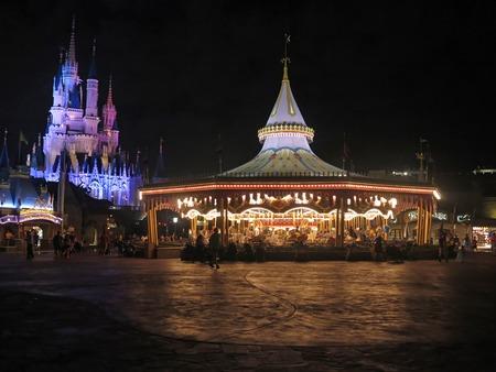 prince charming: ORLANDO, FLORIDA - March 4, 2015 - Prince Charming Regal Carousel and the Cinderella Castle a night at Magic Kingdom, Walt Disney World. Editorial