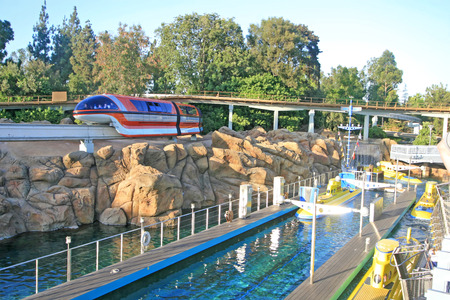 monorail: ANAHEIM, CALIFORNIA - September 16, 2009 - The monorail going over the the Finding Nemo Submarine Voyage in Disneyland.