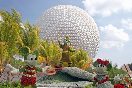 ORLANDO, FLORIDA - May 19, 2008 - The entrance of Epcot during the Flower and Garden Festival with Mickey, Minnie, Goofy and Spaceship Earth.