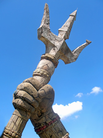 A stone trident with sky and clouds Archivio Fotografico