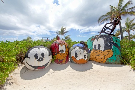 cay: CASTAWAY CAY, THE BAHAMAS - September 19, 2011 - Mount Rustmore featuring Mickey, Pluto, Donald and Goofy, on Castaway Cay, Disney Cruise private island. Editorial