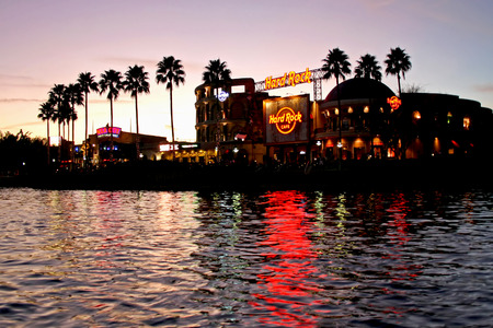hard rock cafe: ORLANDO, FLORIDA - December 16, 2008 - The Hard Rock Cafe in Universal City Walk at sunset with NBA City in the background at Universal Orlando Resort.