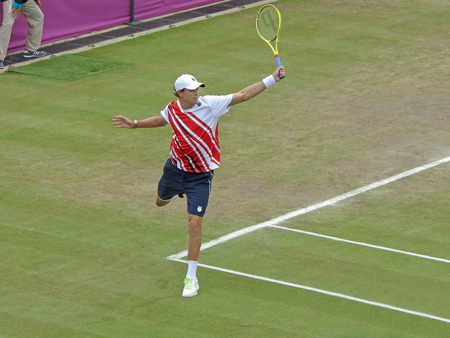 summer olympics: WIMBLEDON, ENGLAND - August 2nd, 2012 - Mike Bryan during one of his double matches at the summer Olympics in London in 2012. They went on to win the gold medal Editorial